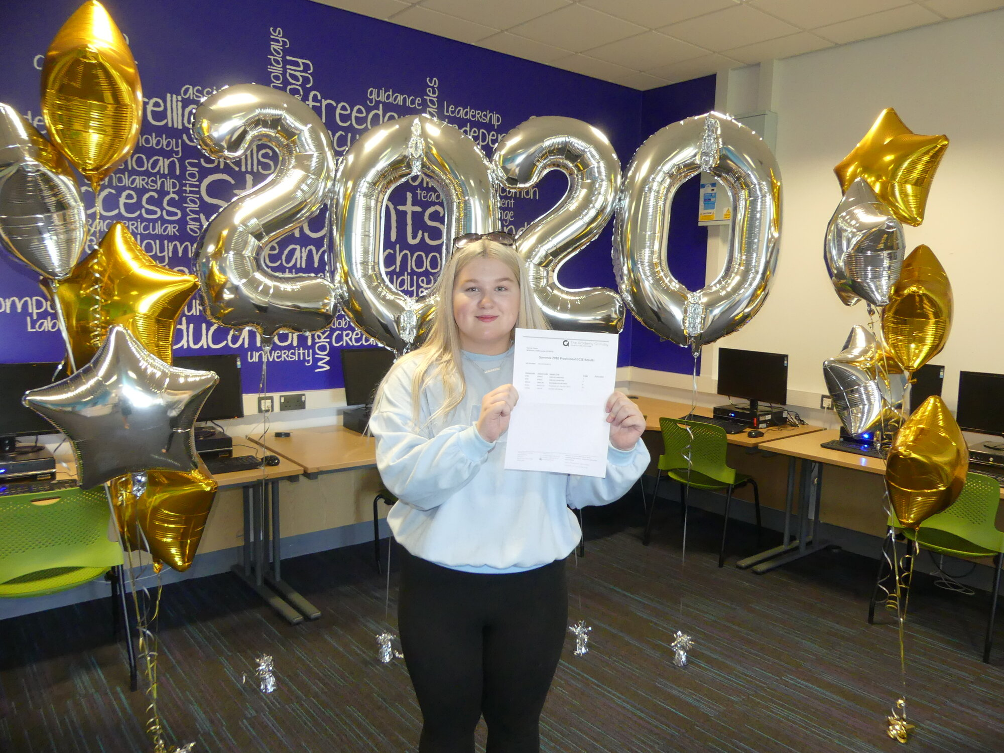 codie louise receiving her gcse education results at the academy grimsby